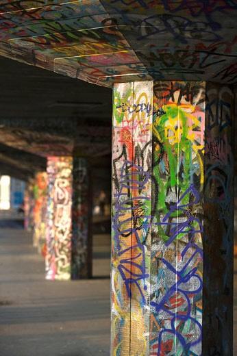 Graffiti painted columns skateboard park  Southbank complex  London  England  UK : Stock Photo