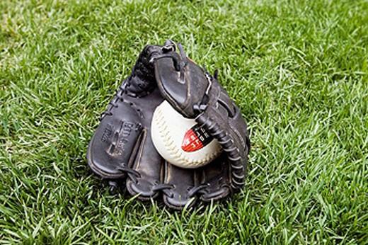 Softball mit and glove : Stock Photo