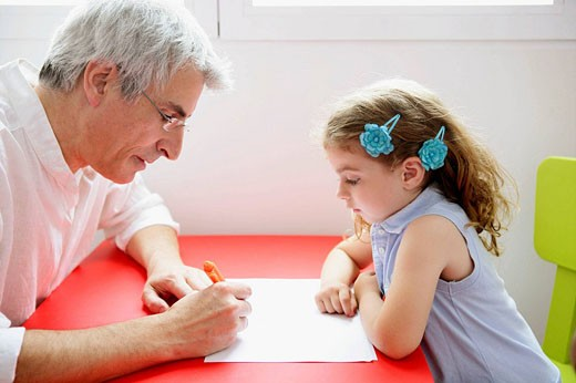 Grandfather teaching the granddaughter : Stock Photo