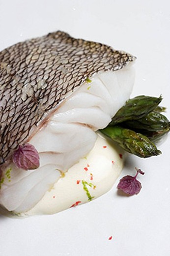 Grouper with lime mousseline sauce and asparagus at restaurant Maruja Limon by Rafael Centeno, Vigo. Pontevedra province, Galicia, Spain : Stock Photo