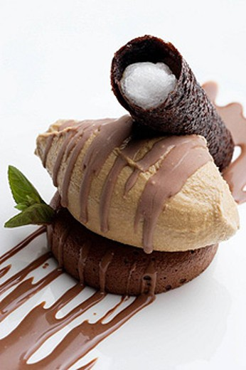 Chocolate cake with coffee ice cream and filled cocoa biscuit at restaurant Yayo Daporta, Cambados. Pontevedra province, Galicia, Spain : Stock Photo
