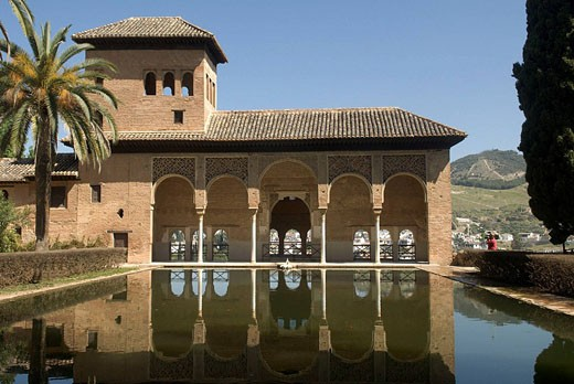 Stock Photo: 1566-447724 Pond and Torre de las Damas in Partal palace complex, Alhambra, Granada. Andalusia, Spain