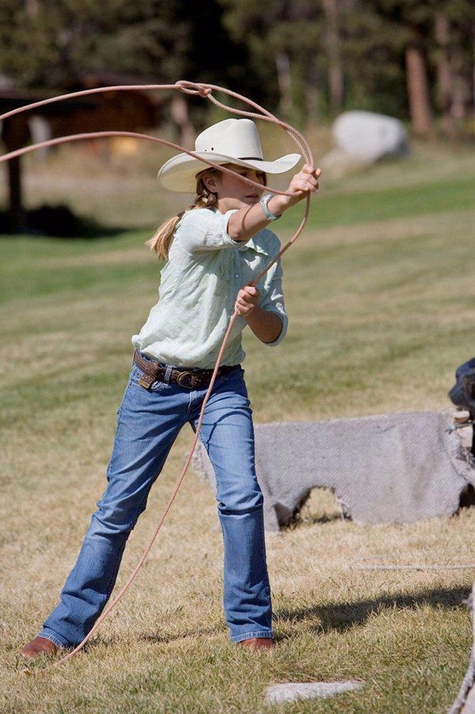 Stock Photo: 1566-449586 Girl throwing a lasso, Lone Mt Ranch, Big Sky, Montana, USA