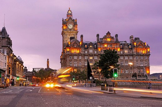 Princes Street, Balmoral Hotel and Carlton Hill in background at dusk, Edinburgh. Lothian Region, Scotland, UK : Stock Photo