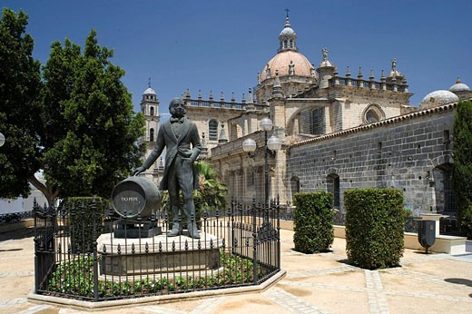 Stock Photo: 1566-453111 Monument to Manuel Maria Gonzalez Angel (founder of González Byass wineries) and cathedral, Jerez de la Frontera. Cadiz province, Andalucia, Spain