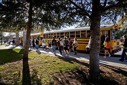 Stock Photo: 1566-453231 California middle school students walk to buses as school is dismissed in the afternoon, USA