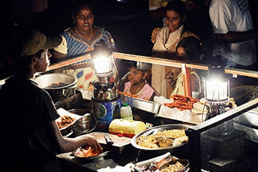 Stock Photo: 1566-455947 People surrounding a food stall at Galle Face Green in Colombo, Sri Lanka, South Asia