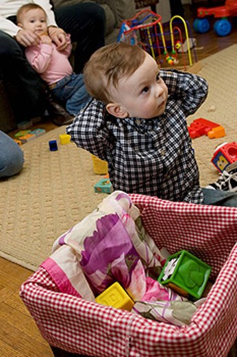 One year old boy attends a playdate with other children : Stock Photo