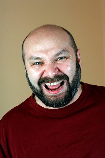 Portrait of russian man laughing in camera : Stock Photo