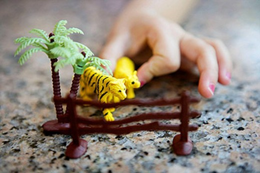 Stock Photo: 1566-458104 Bear and tiger yellow toys on the fence