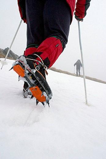 mountaineer climbing a frozen hillside  Picos de Europa mountain range, Cantabria, Spain, Europe : Stock Photo