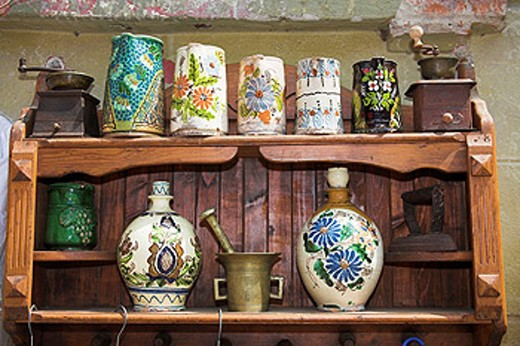 Antique pottery items for sale on shelving outside an antique shop, Sighisoara, Transylvania, Romania : Stock Photo