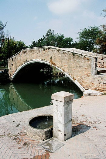 Stock Photo: 1566-458935 Bridge over a canal on the island of Torcello, Venice, Italy