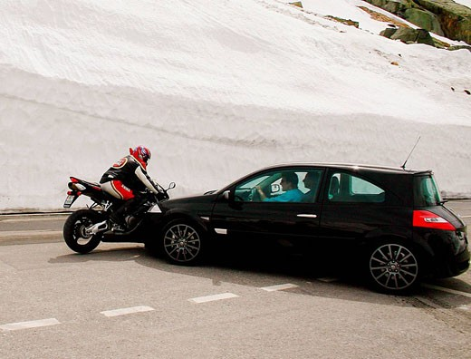 Stock Photo: 1566-461665 Collision between car and motorcycle, Grimselpass, Switzerland