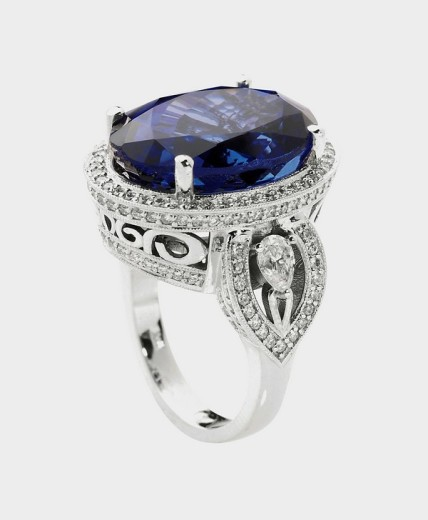 Silver/white gold ring with diamonds and blue stone/tanzanite, jewelry, still life : Stock Photo