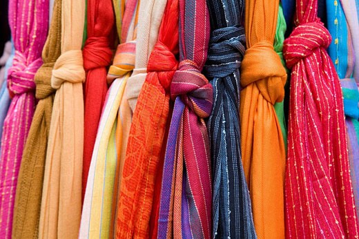 Multicolored scarfs at market : Stock Photo