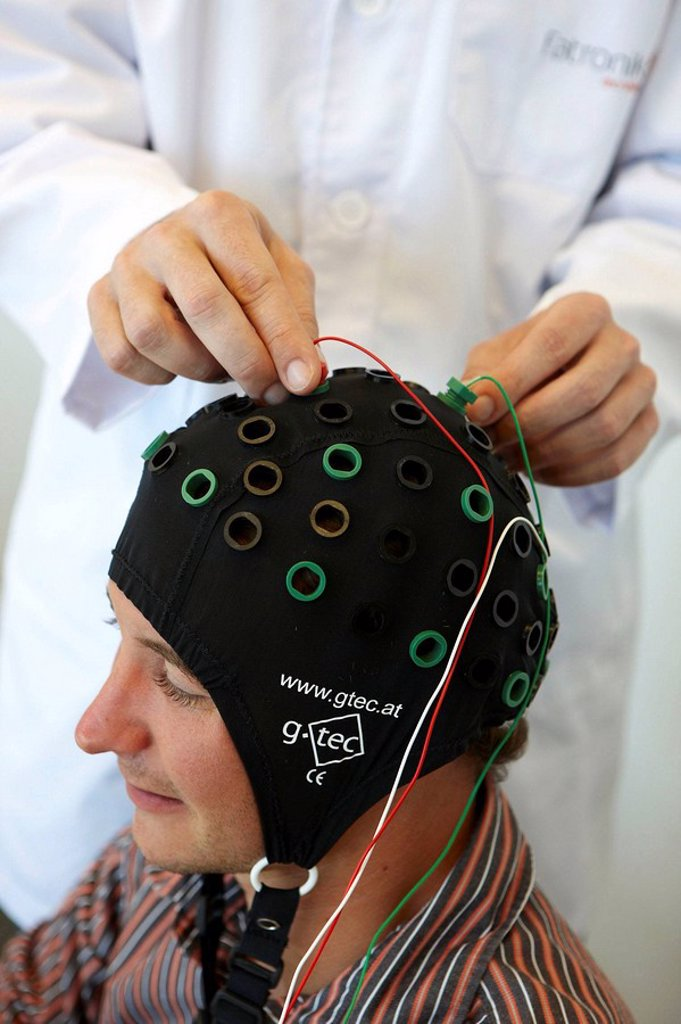 Testing a BCI (Brain-Computer Interface) developed by Health and Quality of life Unit researchers, FIK technology research program for aged and disabled people. Fatronik-Tecnalia, Research and Technology Center, Donostia, Basque Country, Spain : Stock Photo