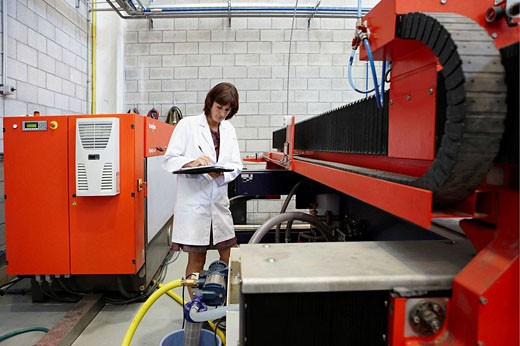 Stock Photo: 1566-467358 Researcher checking abrasive waterjet technology cutting machine for metals and nonmetal materials, Fatronik-Tecnalia, Research and Technology Center, Donostia, Basque Country, Spain