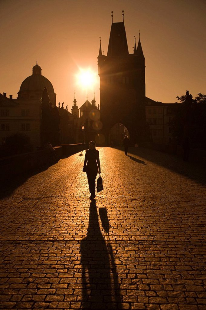 Silhouette of woman walking across king charles iv bridge. Prague. Czech Republic. : Stock Photo