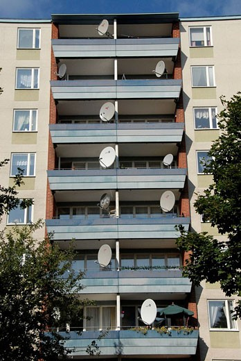 Ronna suburb known as Little Bagdad for its predominately Iraqi refugee population, one of the biggest outside Iraq. Here, apartment building with parabolic antennas, Södertälje, Sweden : Stock Photo