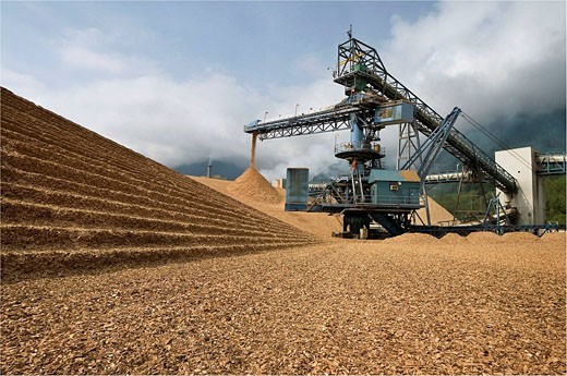 Stock Photo: 1566-469429 Canada, BC, Port Mellon.  Wood chip pile and conveyor at pulp and paper mill.