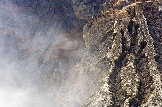 People, including man carrying sulphur on rim of volcano, Kawa Ijen, Ijen Plateau, East Java, Indonesia. People on rim of volcano including sulphur worker carrying sulphur : Stock Photo