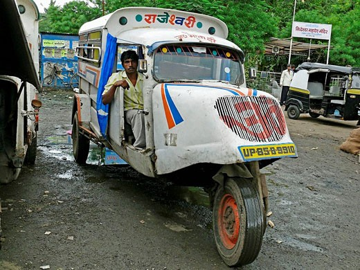 A man driver is travelling Mad max local transports vehicle along the road  Mhow, Madhyaprsdesh, India : Stock Photo