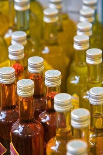 Stock Photo: 1566-475392 Bottles of vinegar on display on market