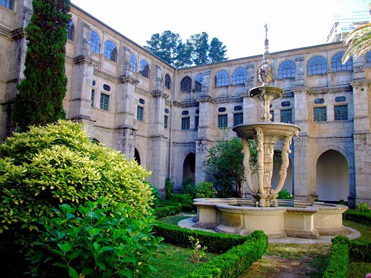 Lesser cloister with the Nereids Baroque fountain (18th century), Benedictine monastery of San Julian, Samos. Lugo province, Galicia, Spain : Stock Photo