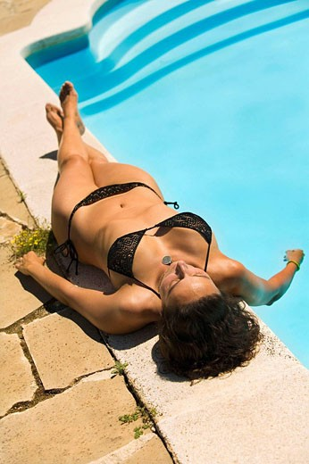 Portrait of a young woman in bathing costume having a sunbathe : Stock Photo
