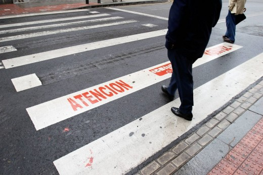 Safety sign on pedestrian crossing, Bilbao. Biscay, Basque Country, Spain : Stock Photo