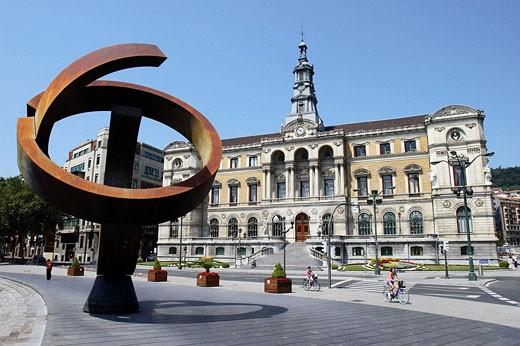 Stock Photo: 1566-478411 ´Variante ovoide de la desocupación de la esfera´, sculpture by Jorge Oteiza in front of the Town Hall, Bilbao. Biscay, Basque Country, Spain
