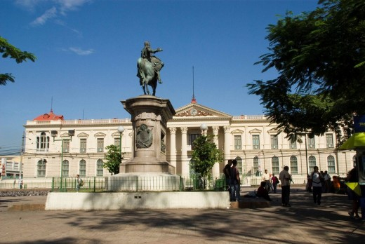 El Salvador.San Salvador city.Square Barrios with the equestrian statue of General Gerardo Barrios erected in 1909 and  The National Palace (1905). Neoclassical. : Stock Photo