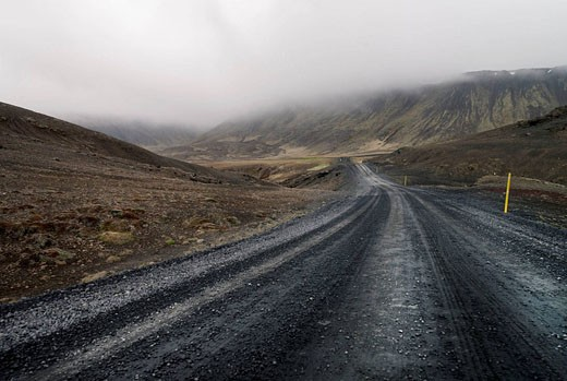 Stock Photo: 1566-481213 unmade road with fog on horizon