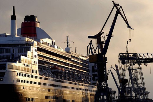 Queen Mary II laying in the dry dock of a Blohm & Voss shipyard in Hamburg, Northern Germany, Europe : Stock Photo