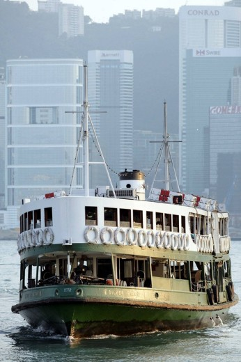 A traditional harbor ferry crossing Hong Kong harbor bay from Hong Kong Island to Kowloon at a sunny afternoon, Hong Kong, China, Southeast Asia : Stock Photo