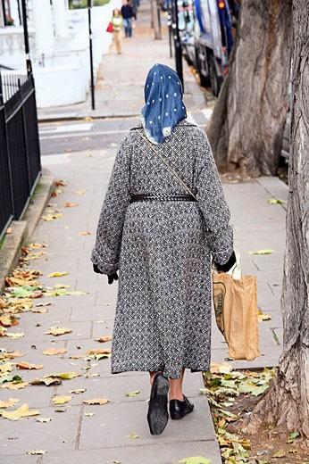 Stock Photo: 1566-483955 Londinenese woman walking in the district of Notting Hill., Women walking in the district of Notting Hill in London.