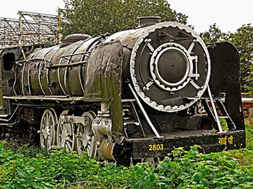 Stock Photo: 1566-484549 Disused steam engine in junkyard. Mhow, Madhyapradesh, India …