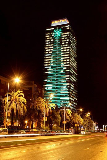 Stock Photo: 1566-488223 Christmas tree lights on building façade, Mapfre Tower, Carrer Marina, Barcelona. Catalonia, Spain