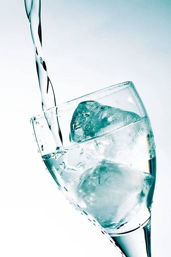 water pouring into a glass : Stock Photo