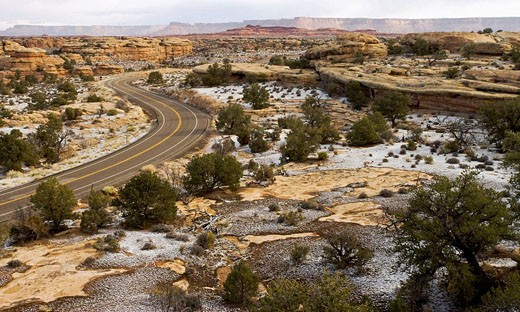 The scenic drive through the Needles District of Canyonlands National Park reveals views of mesas, canyons and sandstone spires : Stock Photo