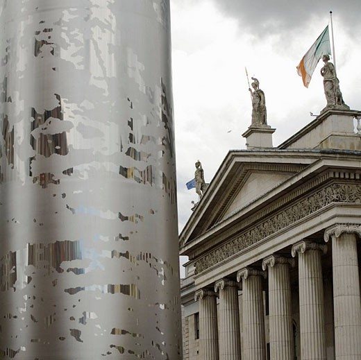 Stock Photo: 1566-494439 The Spike on O´Connell Street, backgroundIrish flag on top of the GPO Building ,Dublin, Ireland