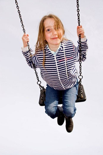 Child on the playground swing : Stock Photo