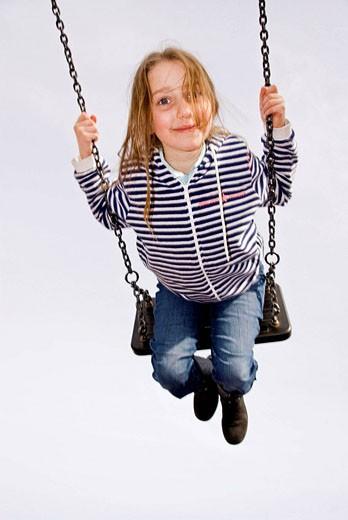 Stock Photo: 1566-499656 Child on the playground swing