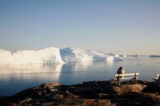 Stock Photo: 1566-501766 Man watching the Ilulissat Kangerlua Glacier also known as Sermeq Kujalleq, Ilulissat, Disko Bay, Greenland