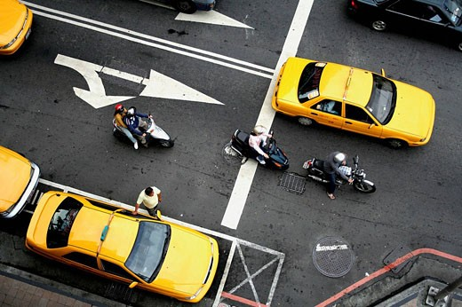 Stock Photo: 1566-502049 Taxis and motorbikes, Jhongiheng Rd, Taichung City, Main Station, Taichung County, West Coast, Taiwan