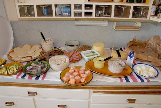 Stock Photo: 1566-508695 Traditional midsummer buffet with herring, egg and salmon, cheese and hard bread or crackers. Medevi, Sweden