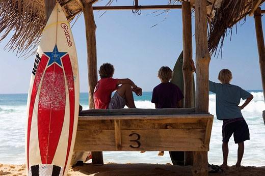 Stock Photo: 1566-510165 Surfers on Hikkaduwa Beach, Sri Lanka