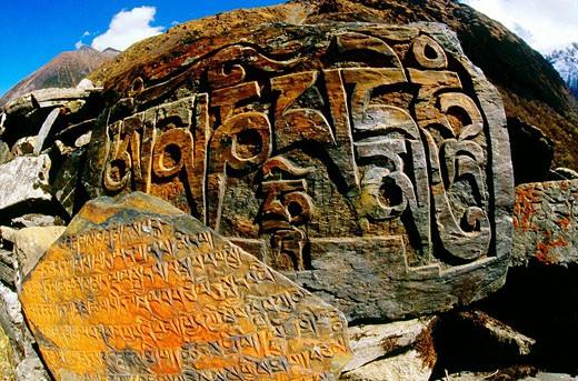 Stock Photo: 1566-511268 Mani stones Burhi Gandaki River Manaslu Himal Nepal