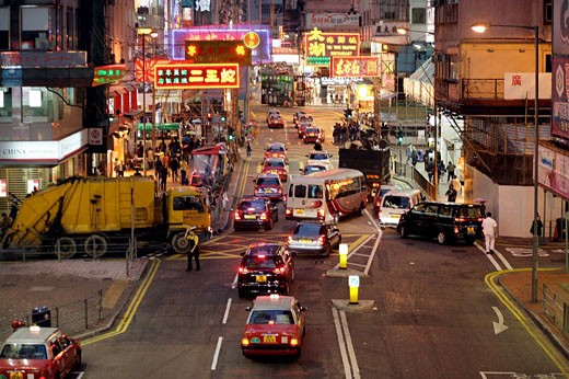 Busy street at night with neon advertisements in chinese letters at Causeway Bay and a garbage truck coming from a side street, Hong Kong Island, Hong Kong, China, Southeast Asia : Stock Photo